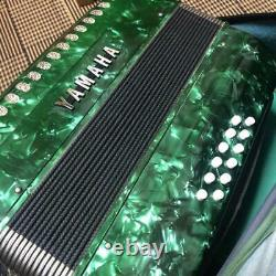 Yamaha accordion musical instrument piano keyboard green